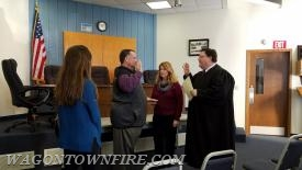 Supervisor Hutton taking the oath of office.