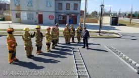 Instructor Pizzi reviewing ladders prior to practical session