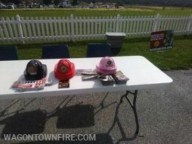 Setting up the table for Fire Prevention at the Fall Harvest